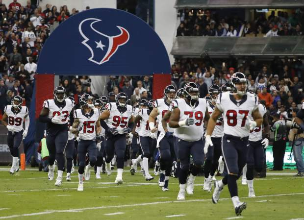 Players for the Houston Texans take the field before an NFL football game against the Oakland Raiders Monday, Nov. 21, 2016, in Mexico City. (AP Photo/Eduardo Verdugo)