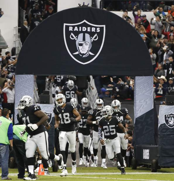 The Oakland Raiders take the field before an NFL football game against the Houston Texans Monday, Nov. 21, 2016, in Mexico City. (AP Photo/Eduardo Verdugo)