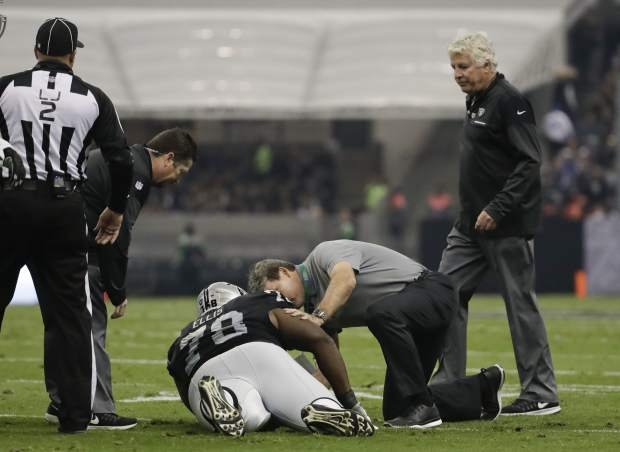 Oakland Raiders defensive tackle Justin Ellis stays down with an injury during the first half of an NFL football game against the Houston Texans Monday, Nov. 21, 2016, in Mexico City. (AP Photo/Rebecca Blackwell)