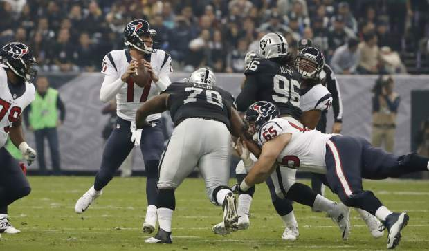 Houston Texans quarterback Brock Osweiler looks to pass during the first half of an NFL football game against the Oakland Raiders Monday, Nov. 21, 2016, in Mexico City. (AP Photo/Eduardo Verdugo)