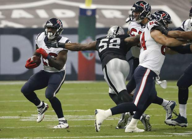 Houston Texans running back Lamar Miller runs with the ball during the first half of an NFL football game against the Oakland Raiders Monday, Nov. 21, 2016, in Mexico City. (AP Photo/Eduardo Verdugo)