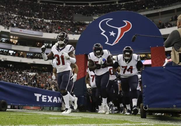 The Houston Texans take the field before an NFL football game against the Oakland Raiders Monday, Nov. 21, 2016, in Mexico City. (AP Photo/Rebecca Blackwell)