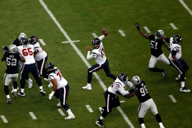 Houston Texans quarterback Brock Osweiler throws a pass during the first half of an NFL football game against the Oakland Raiders Monday, Nov. 21, 2016, in Mexico City. (AP Photo/Dario Lopez-Mills)