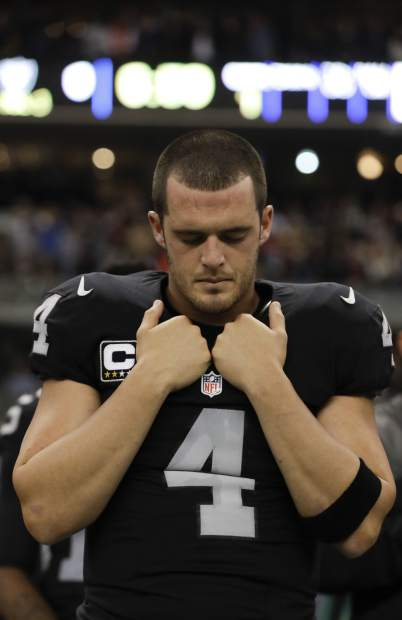 Oakland Raiders quarterback Derek Carr reacts before an NFL football game against the Houston Texans Monday, Nov. 21, 2016, in Mexico City. (AP Photo/Rebecca Blackwell)