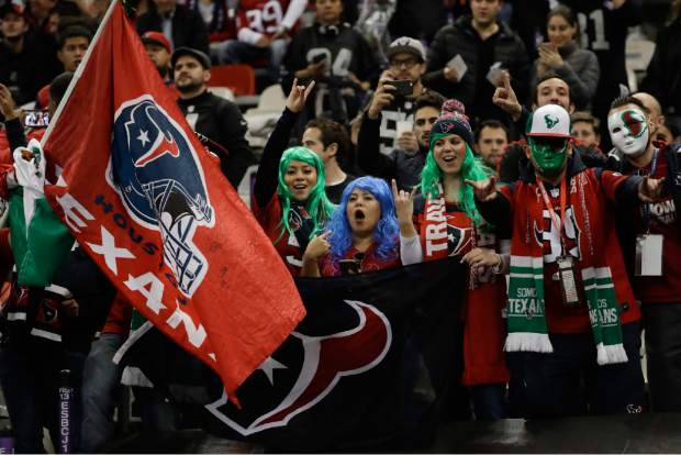 Houston Texans fans react before an NFL football game against the Oakland Raiders Monday, Nov. 21, 2016, in Mexico City. (AP Photo/Rebecca Blackwell)