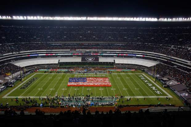 The flag of the United States is seen during the playing of the national anthem before an NFL football game between the Oakland Raiders and the Houston Texans Monday, Nov. 21, 2016, in Mexico City. (AP Photo/Dario Lopez-Mills)