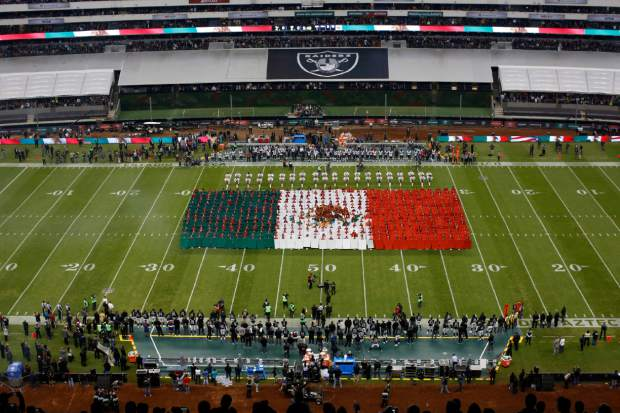 An image of the Mexican flag is seen as the Mexican national anthem is played before an NFL football game between the Oakland Raiders and the Houston Texans Monday, Nov. 21, 2016, in Mexico City. (AP Photo/Dario Lopez-Mills)