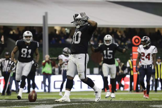 Oakland Raiders running back Jalen Richard celebrates after scoring a touchdown during the first half of an NFL football game against the Houston Texans Monday, Nov. 21, 2016, in Mexico City. (AP Photo/Rebecca Blackwell)