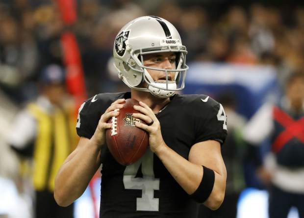 Oakland Raiders quarterback Derek Carr looks to throw a pass during the first half of an NFL football game against the Houston Texans Monday, Nov. 21, 2016, in Mexico City. (AP Photo/Eduardo Verdugo)