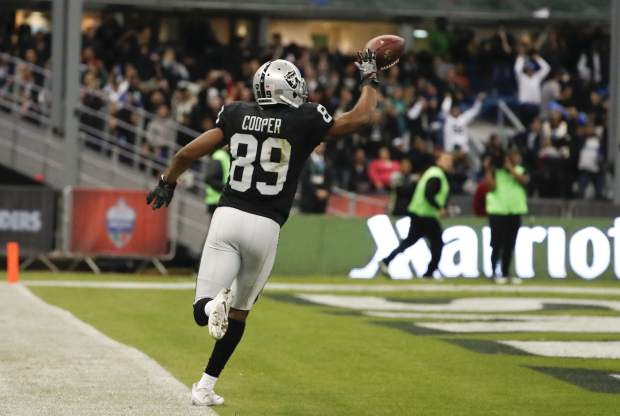 Oakland Raiders wide receiver Amari Cooper scores a touchdown during the second half of an NFL football game against the Houston Texans Monday, Nov. 21, 2016, in Mexico City. (AP Photo/Eduardo Verdugo)