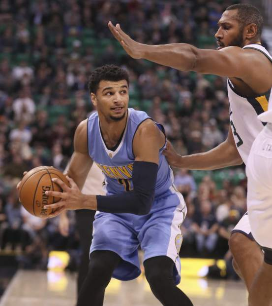 Denver Nuggets guard Jamal Murray (L), looks to pass the ball as Utah Jazz center Boris Diaw (33) defends, during the first half of an NBA basketball game, Wednesday, Nov. 23, 2016, in Salt Lake City. (AP Photo/George Frey)