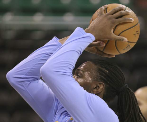 Denver Nuggets forward Kenneth Faried, warms up before an NBA basketball game against the Utah Jazz, Wednesday, Nov. 23, 2016, in Salt Lake City. (AP Photo/George Frey)