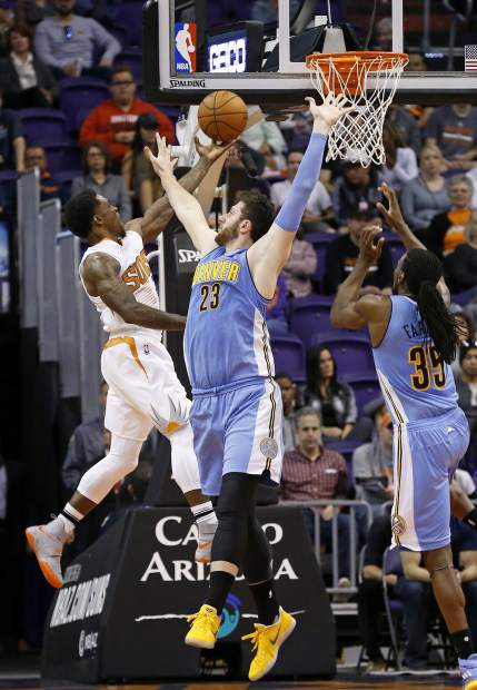 Phoenix Suns guard Eric Bledsoe, left, drives past Denver Nuggets center Jusuf Nurkic (23) and forward Kenneth Faried (35) during the first half of an NBA basketball game Sunday, Nov. 27, 2016, in Phoenix. (AP Photo/Ross D. Franklin)