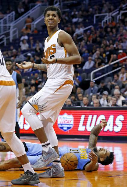 Phoenix Suns forward Marquese Chriss, left, argues with officials after being called for a foul against Denver Nuggets forward Wilson Chandler (21) during the first half of an NBA basketball game Sunday, Nov. 27, 2016, in Phoenix. (AP Photo/Ross D. Franklin)