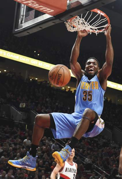 Denver Nuggets forward Kenneth Faried dunks during the first half of an NBA basketball game against the Portland Trail Blazers in Portland, Ore., Sunday, Nov. 13, 2016. (AP Photo/Steve Dykes)