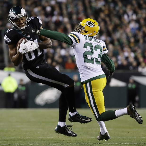 Philadelphia Eagles' Jordan Matthews, left, pulls in a pass against Green Bay Packers' Damarious Randall during the first half of an NFL football game, Monday, Nov. 28, 2016, in Philadelphia. (AP Photo/Michael Perez)