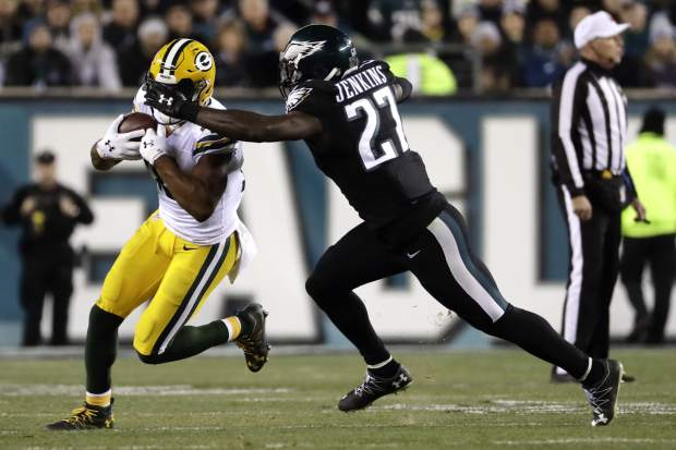 Green Bay Packers' Randall Cobb, left, is grabbed by Philadelphia Eagles' Malcolm Jenkins during the first half of an NFL football game, Monday, Nov. 28, 2016, in Philadelphia. (AP Photo/Michael Perez)