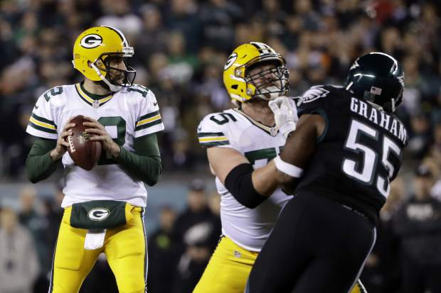 Green Bay Packers' Aaron Rodgers (12) looks to pass during the first half of an NFL football game against the Philadelphia Eagles, Monday, Nov. 28, 2016, in Philadelphia. (AP Photo/Matt Rourke)