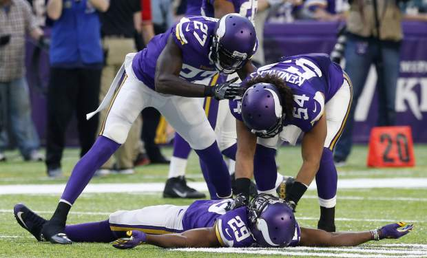 Minnesota Vikings cornerback Xavier Rhodes (29) celebrates with teammate Jayron Kearse (27) and Eric Kendricks (54) after intercepting a pass during the second half of an NFL football game against the Arizona Cardinals Sunday, Nov. 20, 2016, in Minneapolis. (AP Photo/Jim Mone)