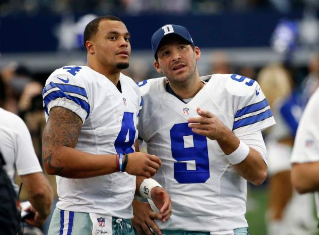 Dallas Cowboys' Dak Prescott (4) and Tony Romo (9) talk on the sideline in the first half of an NFL football game against the Baltimore Ravens on Sunday, Nov. 20, 2016, in Arlington, Texas. (AP Photo/Michael Ainsworth)