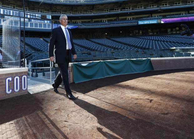 Newly-named Colorado Rockies manager Bud Black cats a long shadow as he stops on the warning track to see the diamond in Coors Field following a news conference to introduce him as the new skipper on Monday, Nov. 7, 2016, in Denver. Black succeeds Walt Weiss, who left after four seasons as manager at the conclusion of the regular season. (AP Photo/David Zalubowski)