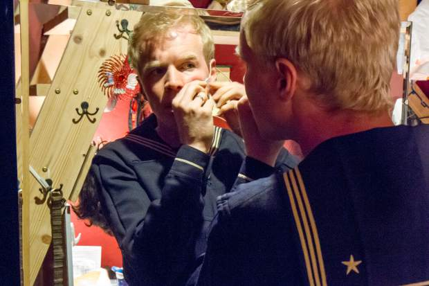 Micha Schoepe prepares his microphone before the showing of Sweeney Todd.