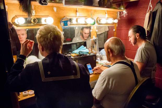 Micha Schoepe(left), Bob Moore(middle) and Lance Schober get ready before the showing of Sweeney Todd.
