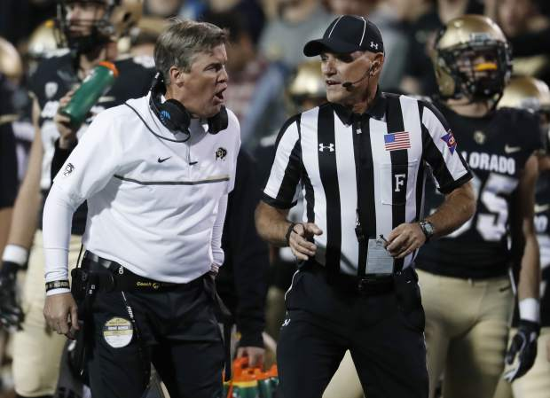 Colorado coach Mike MacIntyre, left, argues a call with field judge Kevin Kieser during the first half of the team's NCAA college football game against UCLA on Thursday, Nov. 3, 2016, in Boulder, Colo. (AP Photo/David Zalubowski)