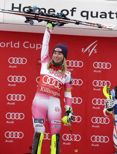Mikaela Shiffrin, of the United States, celebrates winning the women's FIS Alpine Skiing World Cup slalom race, Sunday, Nov. 27, 2016, in Killington, Vt. (AP Photo/Mike Groll)
