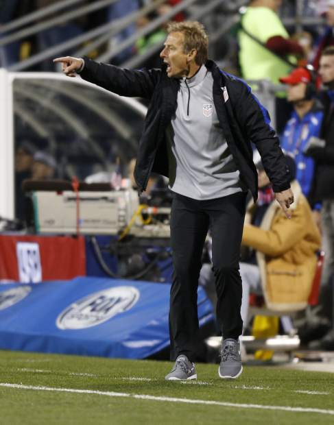 United States head coach Jurgen Klinsmann shouts to his team against Mexico during the first half of a World Cup qualifying soccer match Friday, Nov. 11, 2016, in Columbus, Ohio. (AP Photo/Jay LaPrete)