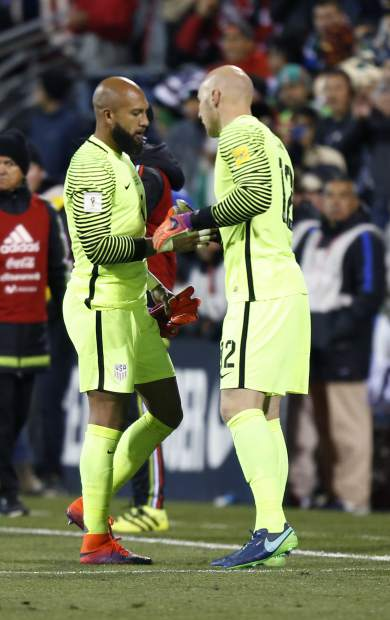 United States' Brad Guzan, right, substitutes for teammate Tim Howard after Howard was injured during the first half of the team's World Cup qualifying soccer match against Mexico on Friday, Nov. 11, 2016, in Columbus, Ohio. (AP Photo/Jay LaPrete)