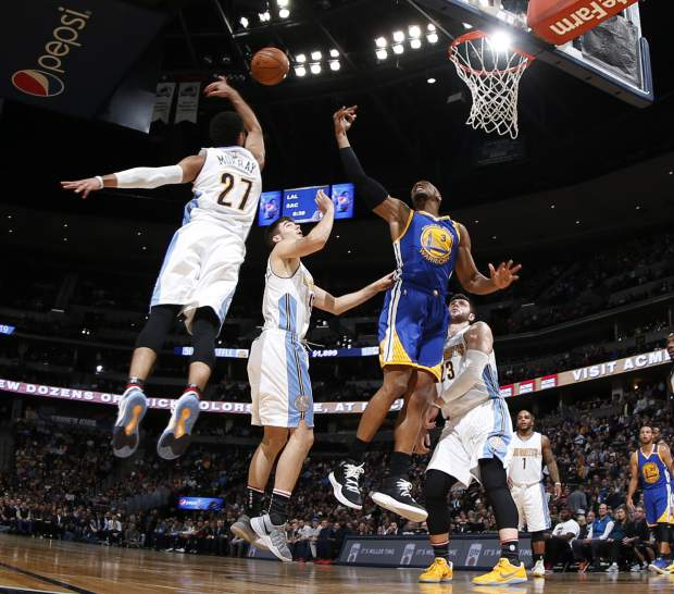 Golden State Warriors forward David West, third from left, has his shot blocked while driving the lane for a basket past, from left, Denver Nuggets guard Jamal Murray, forward Juancho Hernangomez, of Spain, and center Jusuf Nurkic, of Bosnia, in the first half of an NBA basketball game Thursday, Nov. 10, 2016, in Denver. (AP Photo/David Zalubowski)
