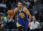 Golden State Warriors guard Stephen Curry drives down the court against the Denver Nuggets in the first half of an NBA basketball game Thursday, Nov. 10, 2016, in Denver. (AP Photo/David Zalubowski)
