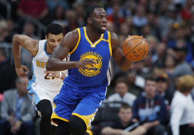 Golden State Warriors forward Draymond Green, front, picks up the ball in front of Denver Nuggets guard Jamal Murray in the first half of an NBA basketball game Thursday, Nov. 10, 2016, in Denver. (AP Photo/David Zalubowski)