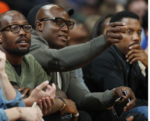 Denver Broncos linebackers Von Miller, left, and DeMarcus Ware look on from center court seats as the Denver Nuggets host the Golden State Warriors in the first half of an NBA basketball game Thursday, Nov. 10, 2016, in Denver. (AP Photo/David Zalubowski)