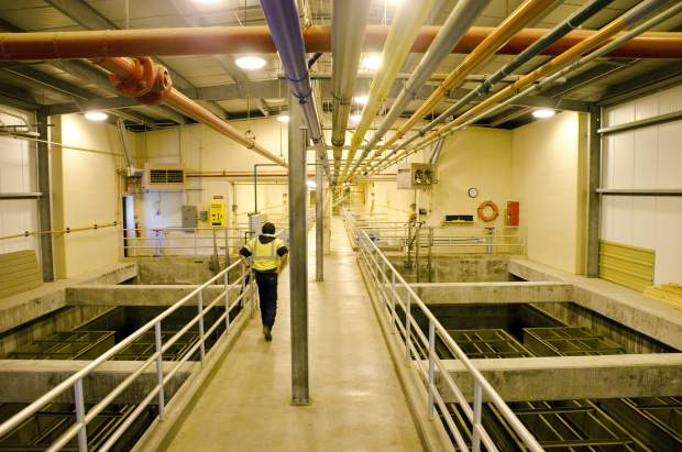 Wade inspects the settling process at Glenwood's current water treatment plant.