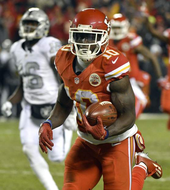 Kansas City Chiefs wide receiver Tyreek Hill (10) runs for a touchdown on a 78-yard kickoff return during the first half of an NFL football game against the Oakland Raiders in Kansas City, Mo., Thursday, Dec. 8, 2016. (AP Photo/Ed Zurga)