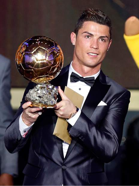 FILE - In this Monday, Jan. 13, 2014 file photo, Real Madrid's Christiano Ronaldo of Portugal holds the trophy for world player of the year at the FIFA Ballon d'Or 2013 Gala in Zurich, Switzerland. After giving a European Championship title to Portugal and another Champions League trophy to Real Madrid, Cristiano Ronaldo ends the year with something just for himself — on Monday Dec. 12, 2016 he won his fourth world player of the year award. (AP Photo/Michael Probst, File)