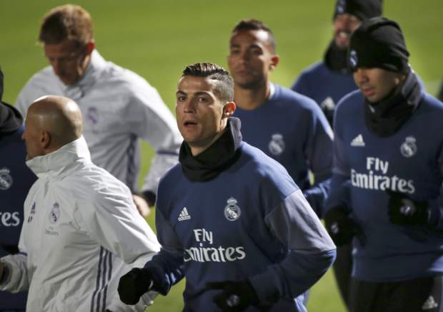 Real Madrid's Cristiano Ronaldo warms up with teammates during a training session in Yokohama near Tokyo, Monday, Dec. 12, 2016. Real Madrid and Mexico's Club America will play in the semifinal of the FIFA Club World Cup soccer tournament on Dec. 15. (AP Photo/Koji Sasahara)