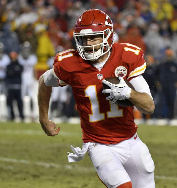Kansas City Chiefs quarterback Alex Smith (11) runs for a 10-yard touchdown during the first half of an NFL football game against the Denver Broncos in Kansas City, Mo., Sunday, Dec. 25, 2016. (AP Photo/Ed Zurga)