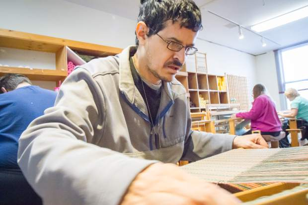 Raul Delgado is one of 14 weavers from Mountain Valley Developmental Services who works at Art on 8th in downtown Glenwood.