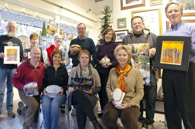 Some of the member artists at Cooper Corner Gallery show off their wares.