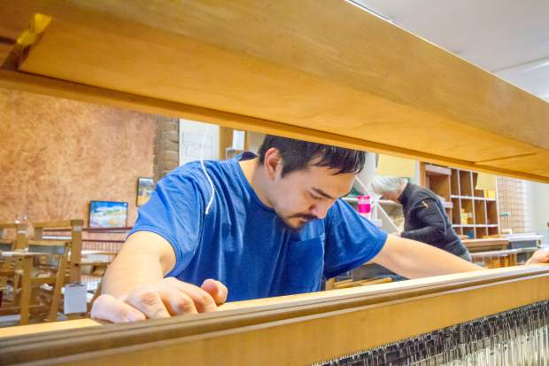 John Rippy is one of 14 weavers from Mountain Valley Developmental Services who works at Art on 8th in downtown Glenwood.