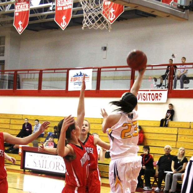 Former Rifle High School standout Chante Church (23) goes up for a layup during her senior season with the Bears at a game in Montrose.