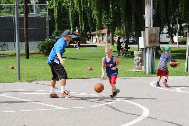 Former Glenwood Springs guard Mason Yellico instructs a youth camper during this summer's Game On basketball camp at Sayre Park. (PROVIDED)