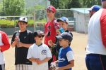 Area baseball players await instructions at the Game On baseball camp at Sayre Park this summer. (PROVIDED)