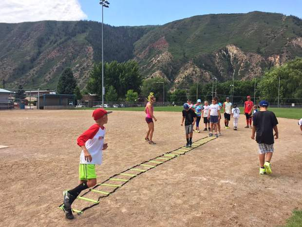 Youth athletes take part in ladder drills as Glenwood Springs assistant basketball coach Deanna Spracher instructs during this summers Game On camp at Sayre Park. (PROVIDED)