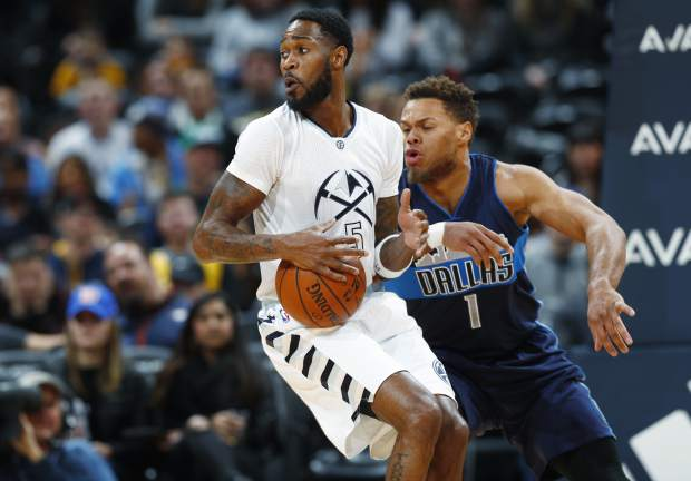 Denver Nuggets guard Will Barton, front, picks up a loose ball in front of Dallas Mavericks guard Justin Anderson in the first half of an NBA basketball game Monday, Dec. 19, 2016, in Denver. (AP Photo/David Zalubowski)