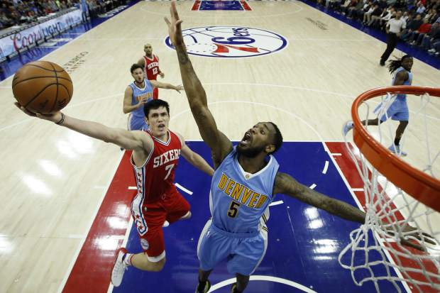 Philadelphia 76ers' Ersan Ilyasova (7) goes up for a shot against Denver Nuggets' Will Barton (5) during the first half of an NBA basketball game, Monday, Dec. 5, 2016, in Philadelphia. (AP Photo/Matt Slocum)
