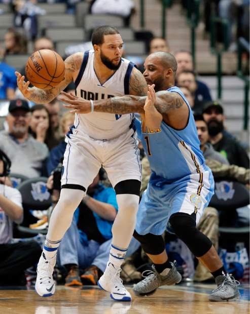 Dallas Mavericks guard Deron Williams (8) works against Denver Nuggets' Jameer Nelson (1) in the first half of an NBA basketball game, Monday, Dec. 12, 2016, in Dallas. (AP Photo/Tony Gutierrez)